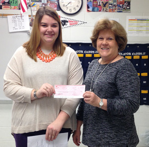President Allie Rumohr presents Sue Napper, President of the Kiwanis Club of Owensboro, a check for $1,150.
