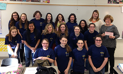 Members of the Daviess County Key Club pictured with Kiwanis Club of Owensboro president, Sue Napper.